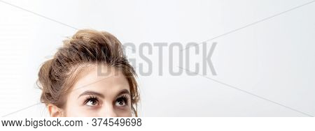 Half Face Of Beautiful Young Caucasian Woman Looking Up On White Background. Girl Looking Upwards Wi