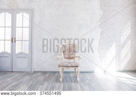Classic Milky Chair In An Empty Interior