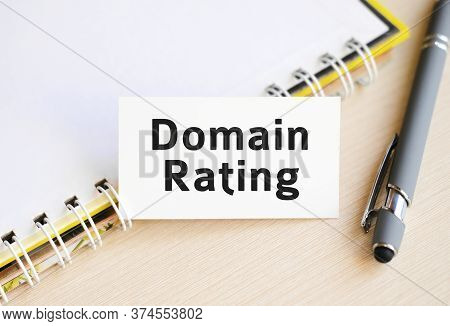 Domain Rating - Text On A Notebook With A Spring And A Gray Pen