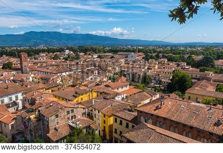 Lucca, Italy - August 14, 2019: Panoramic View Of Lucca From Guinigi Tower Balcony With Oak Trees, T