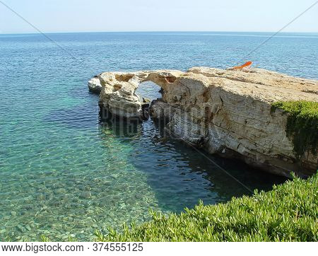 Coast Of Crete With Arch And Transparent Water. Greece