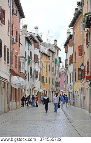 Rovinj, Croatia - October 15, 2014: Tourists Walking At Pedestrian Zone Carrera Street Autumn Day In