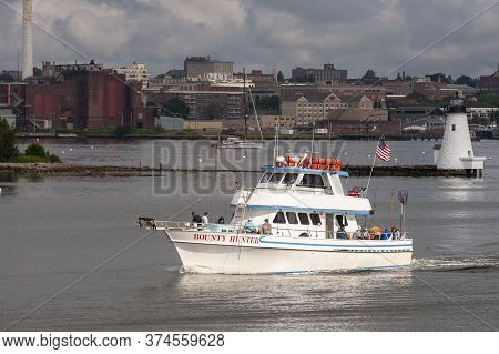 Fairhaven, Massachusetts, Usa - July 1, 2020: Sun Spotlights Charter Fishing Boat Bounty Hunter Thro