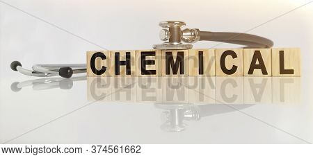 Chemical The Word On Wooden Cubes, Cubes Stand On A Reflective White Surface, On Cubes - A Stethosco