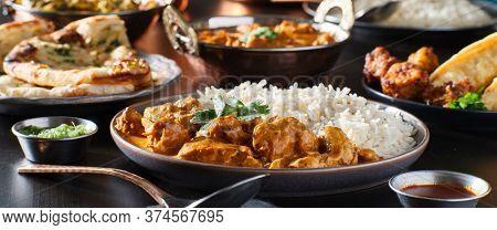 indian chicken tikka masala on plate with basmati rice