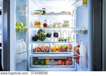 Open Refrigerator Or Fridge Door With Food Inside