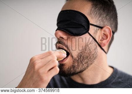 Blind Taste. Blindfolded Food Test. Man Face