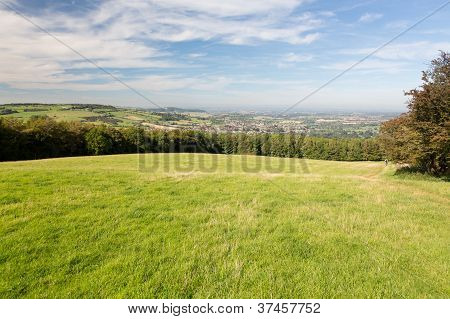 View over Winchcombe from the barrow at Belas Nap in English Cotswolds poster
