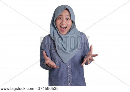 Portrait Of Cute Young Asian Muslim Lady Wearing Hijab Shows Surprised Or Shocked Expression With Op