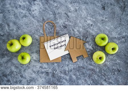 The New Normal After Covid-19, Contactless Delivery Text On Notepad Among Apples And With Shopping B