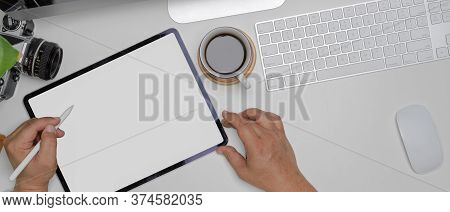 Male Hands Using Mock-up Tablet On White Worktable With Computer Device