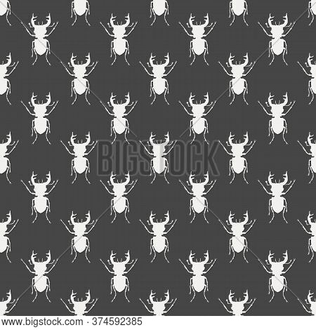 Seamless Pattern With White Silhouettes Of Stag Beetles On Black Backdrop. Beetles On The Background