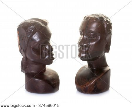 Ebony Scupture Face In Front Of White Background
