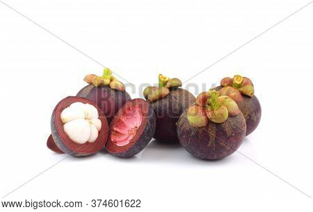 Queen Of Thai Fruit - Group Of Mangosteens And Half Piece On White Background