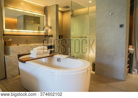 Khaoyai / Thailand - July 1 2020: White Bathtub In Open Bathroom In Hotel Bedroom With Luxury Decora