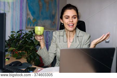 Smiling Young Woman Working Home Near Laptop, Shrugging With Hands Sideways, Smile Saying Sorry Can