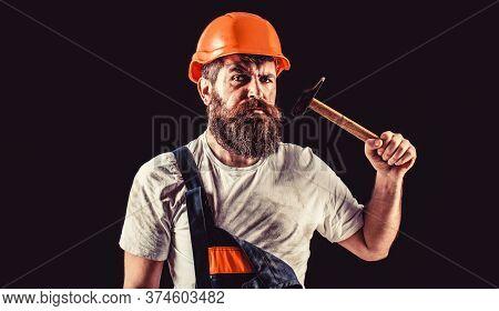 Bearded Builder Isolated On Black Background. Hammer Hammering. Builder In Helmet, Hammer, Handyman,