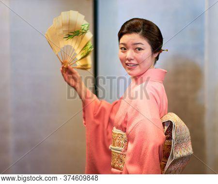 Kyoto / Japan - April 13, 2018: Beautiful Japanese Maiko Geisha Apprentice Girl Dressed In Kimono, P