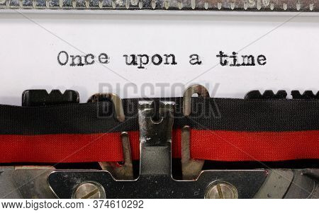 Text Once Upon A Time On White Paper Of An Old Vintage Typewriter