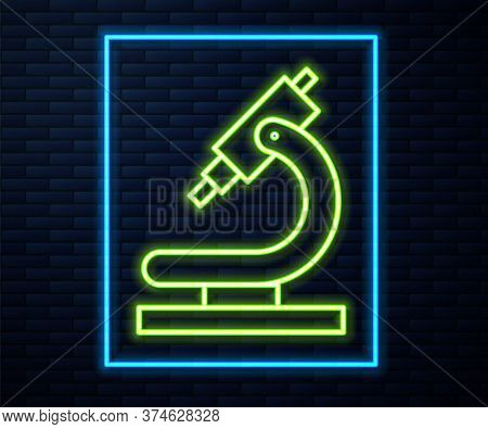 Glowing Neon Line Microscope Icon Isolated On Brick Wall Background. Chemistry, Pharmaceutical Instr