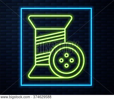 Glowing Neon Line Sewing Thread On Spool And Button Icon Isolated On Brick Wall Background. Yarn Spo
