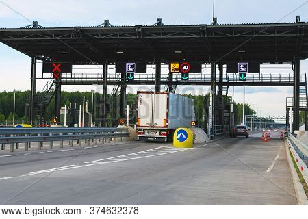Moscow 25/06/2019 Pay Point On Toll Road, Truck And Car Paying Fare At Toll Gate