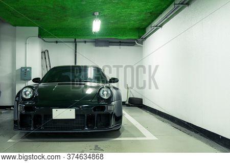Seoul, South Korea - 03.11.18: Tuning Black Porsche 911. Black Classic Porsche 911 Stands In The Und
