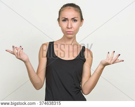 Stressed Young Woman With Brown Hair Shrugging Shoulders