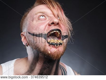 Portrait Of A Scary Mad Man With Maggots In His Mouth