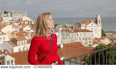 Beautiful Woman In Lisbon Alfama On A Sunny Day - Lisbon, Portugal - October 15, 2019