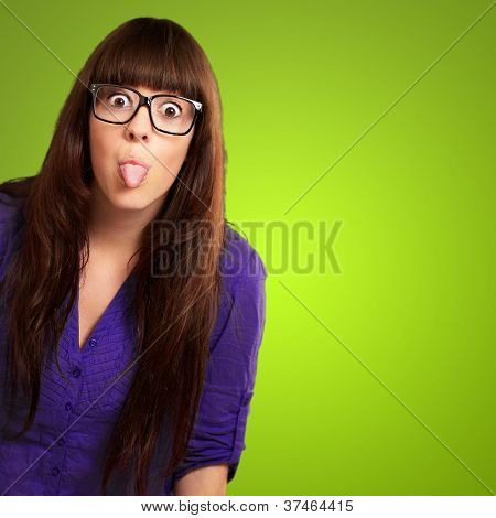Crazy Woman With Stick Out Tongue Isolated On Green Background