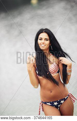 Beautiful Woman In Swimwear Near The Pool On Tropical Resort