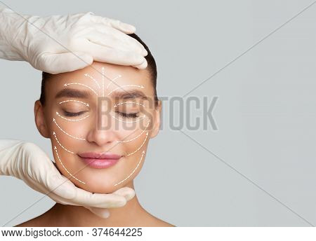 Frontal Portrait Of Woman Getting Spa Treatment From Beautician In Protective Gloves, Isolated On Gr