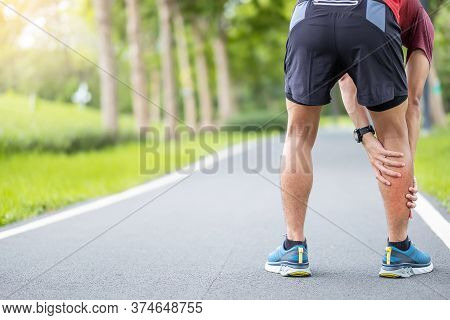 Young Adult Male With His Muscle Pain During Running. Runner Man Having Leg Ache Due To Calf Muscle