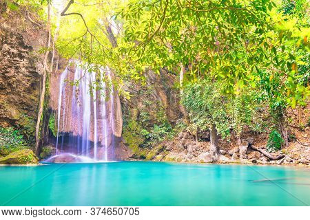 Tropical Waterfall With Emerald Lake In Jungle Forest