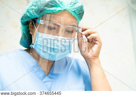 Asian Doctor Wearing Face Shield And Ppe Suit To Check Patient Protect Safety Infection Covid-19 Cor