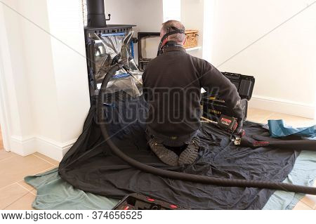 Buckingham, Uk - April 20, 2020. Modern Chimney Sweep Sweeping Chimney With A Flue Liner In A Home,