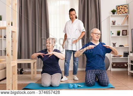 Physiotherapist Following The Evolution Of Patients. Home Assistance, Physiotherapy, Healthy Lifesty