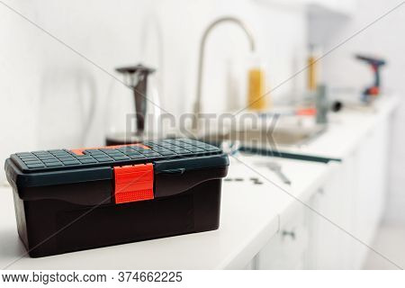 Selective Focus Of Toolbox On Worktop In Kitchen