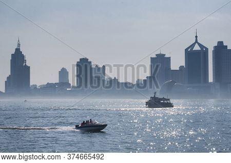 Qingdao, China.  June 25, 2016. Motorboats On Jiaozhou Bay In The City Of Qingdao On A Hazy Sunny Da