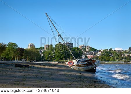 Sailboat Wreck Kitsilano Beach Vancouver. A Beached Sailboat The Day After A Storm Hits Vancouver, B