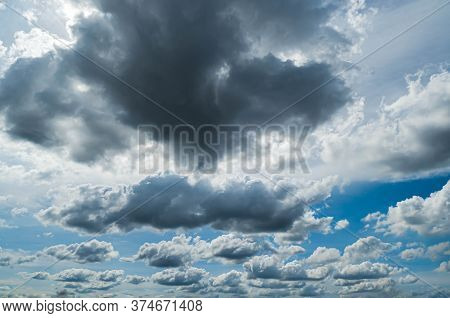 Rainy Cloud On Blue Sky, Stormy Sky Nature Background In Rainy Weather.