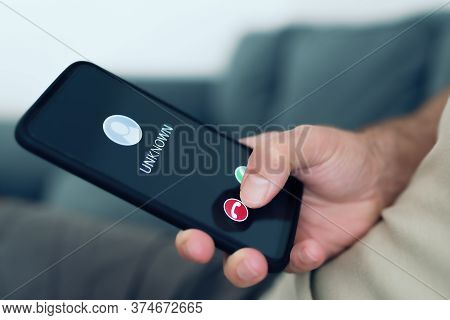 Close-up View Of Person Rejecting Call From Unknown Caller Or Unknown Number On Smartphone, Phone Sc