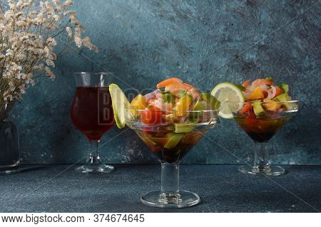 Ceviche Salad With Shrimps, Oranges And Avocado In Glass Bowl On A Dark Or Grey Background. Latin Am
