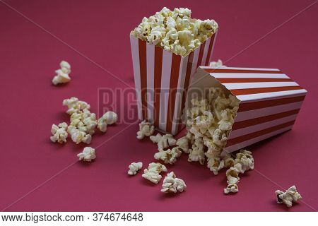 Overhead View Of Some Popcorn On Fuchsia Background Conceptual Cinema, Filming, Movies, Feature Film