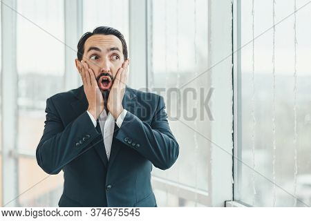 Man Looking Surprised, Open-mouthed, Shocked, Keeping Hands On Cheeks, Realizing A New Thought, Idea
