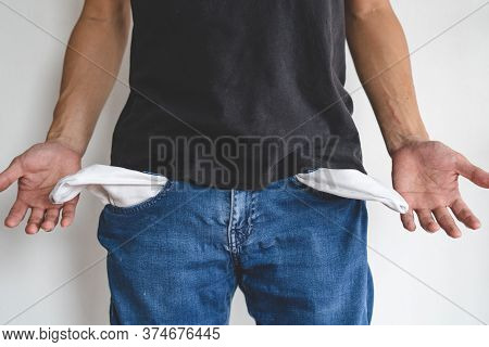 Bankruptcy Economic Financial Concept. Person Open His Empty Wallet Without Money To Pay Debt In Pay