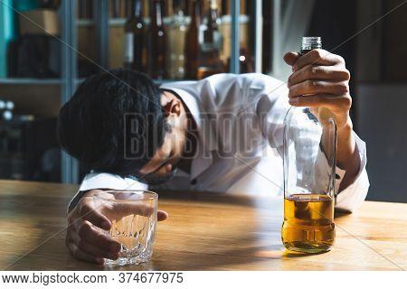 Drunkard Fall Asleep On The Table At Bar.