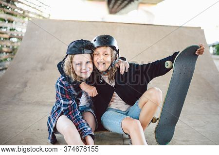 Group Of Friends Athletes Skateboarders Posing Together In A Skate Park. Caucasian Children Having F