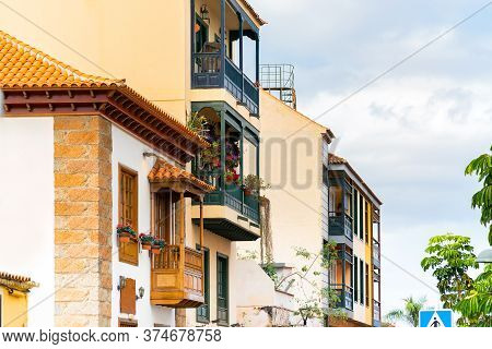 Colorful Buildings With A Wooden Balconies On A Street In Spanish Town Puerto De La Cruz On A Sunny